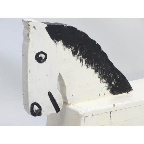 24 - Rocking horse : a scratch built and painted wooden rocking horse on bows with brown painted back and...