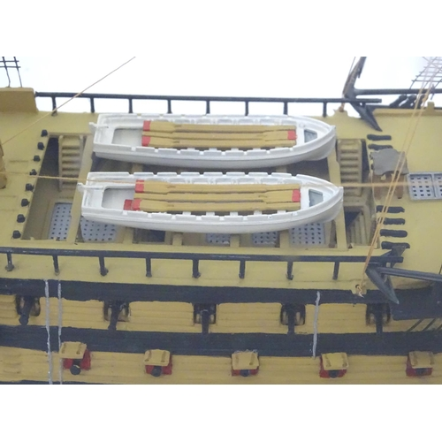 11 - A model of HMS Victory in a perspex case...