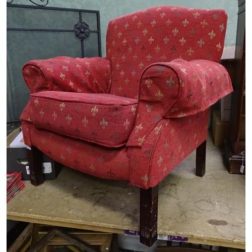 3 - A upholstered armchair with fleur de lys decoration...