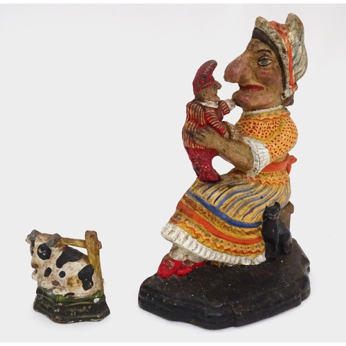 31 - A cast iron Punch and Judy door stop and a cow door stop. Largest approx. 11 2/2