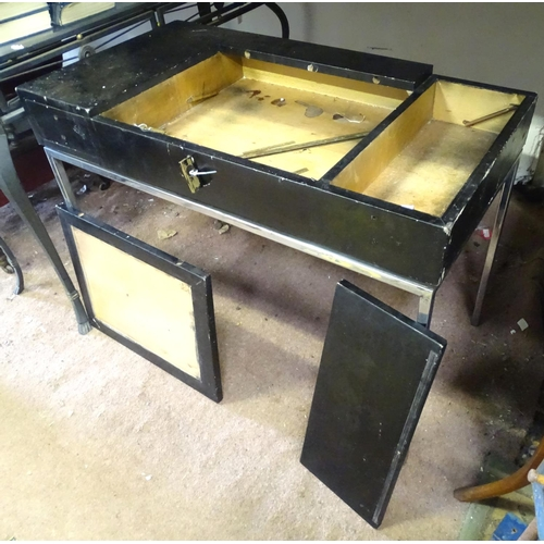 36 - A retro desk with central lifting top and a chromed base. Approx.  37