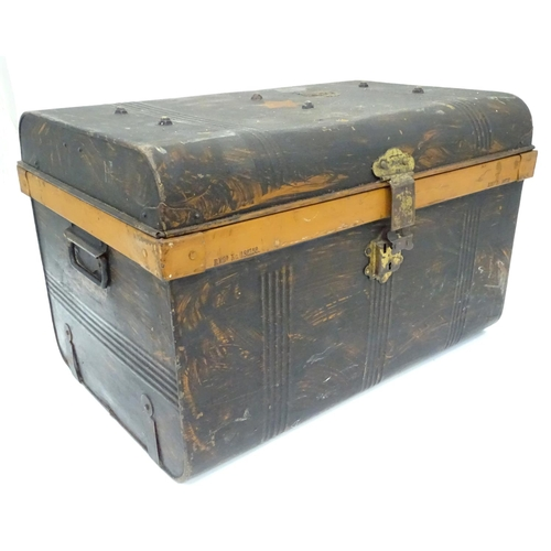 37 - A painted tin trunk, with a suitcase and two attache cases/ The largest approx. 25