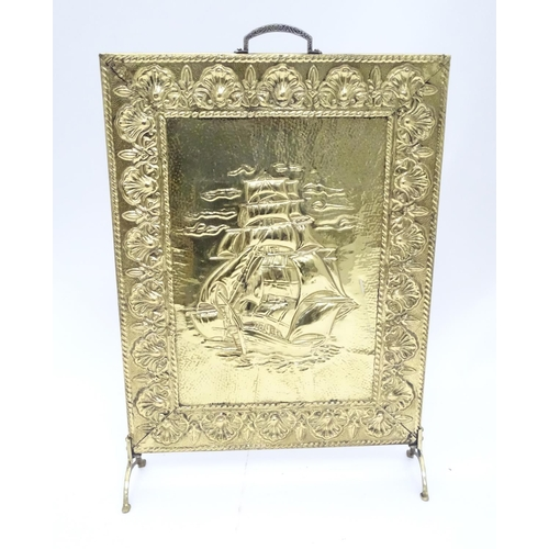 54 - A brass fire guard with ship decoration. Approx. 26 1/2