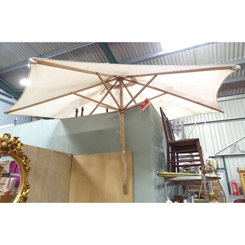 56 - A large parasol. Approx. 7ft wide...