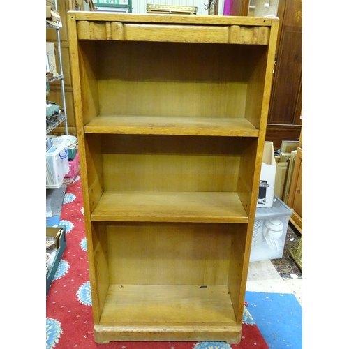 58 - An early 20thC small oak bookcase. Approx. 48 1/4