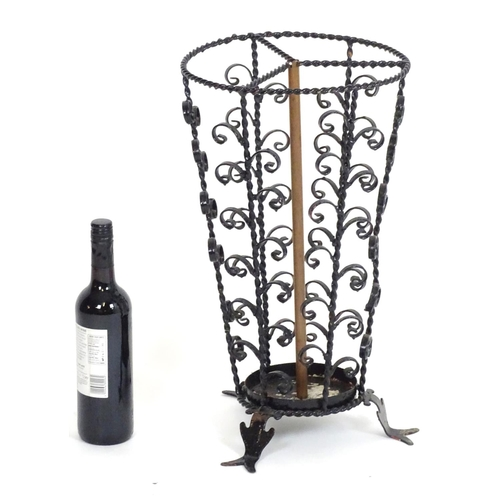1018 - An early 20thC cast stick / umbrella stand with twist and scroll detail. Approx. 20