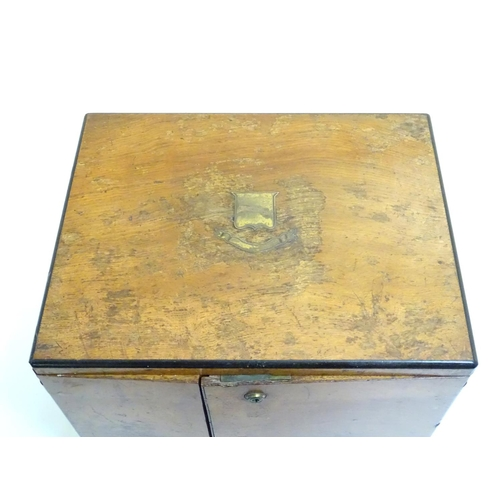 1016 - A small late 19thC oak and walnut cased military campaign chest with twin brass recessed handles, th...
