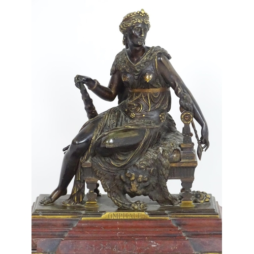 1017 - A 19thC bronze sculpture modelled as Omphale, Queen of Lydia seated on the skin of a lion and holdin...