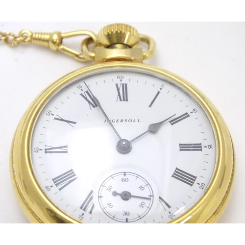 564 - An Ingersoll gold plated open faced pocket watch on gold plated watch chain. White enamel dial with ...