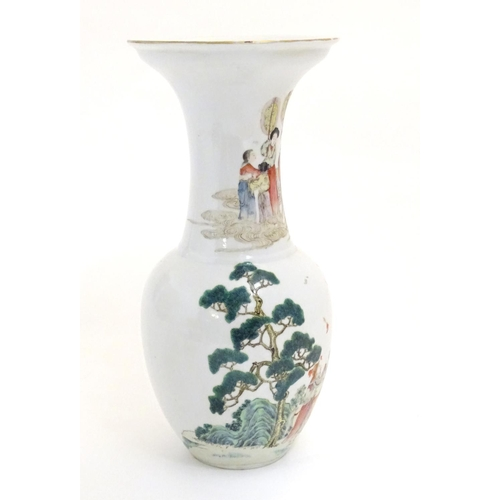 5 - An Oriental baluster vase with an elongated neck and flared rim, the body decorated with figures and...