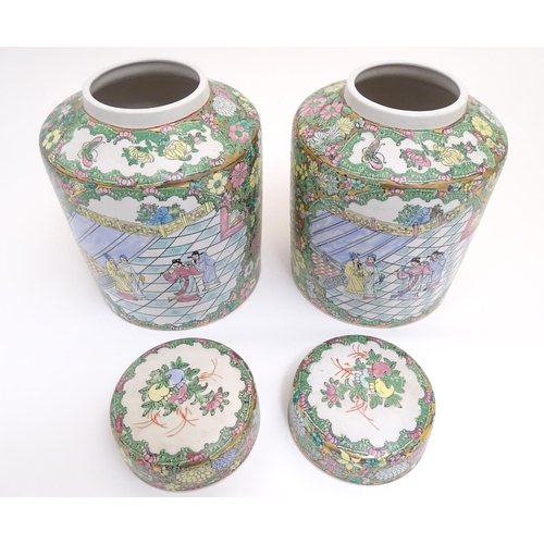 8 - A pair of Chinese jars and covers profusely decorated with flowers and foliage, with two lobed centr...