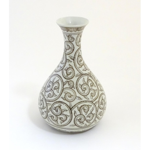6 - A Chinese baluster vase with a flared rim decorated with stylised scrolling foliage with dotwork det...