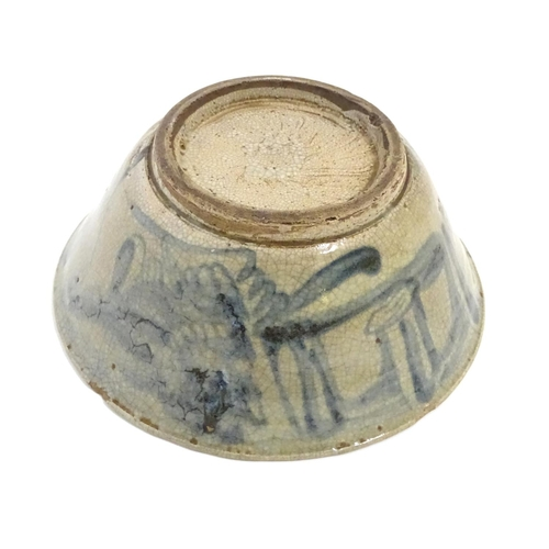 13 - A Chinese crackle glaze bowl with blue brushwork detail. Approx. 3 3/4