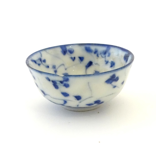 24 - Three assorted Oriental blue and white wares to include saki cup, tea bowls etc. Character marks und...