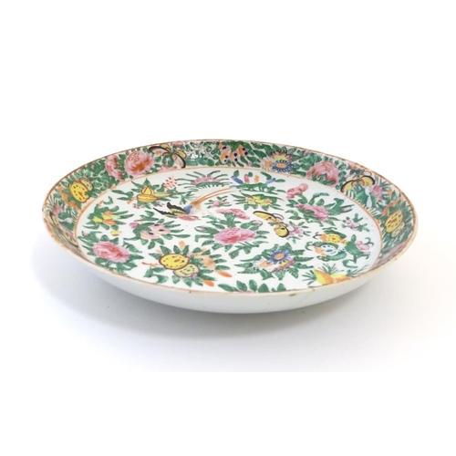 31 - A Chinese Cantonese plate / dish decorated with birds, butterflies, flowers and foliage. Approx. 9 1...