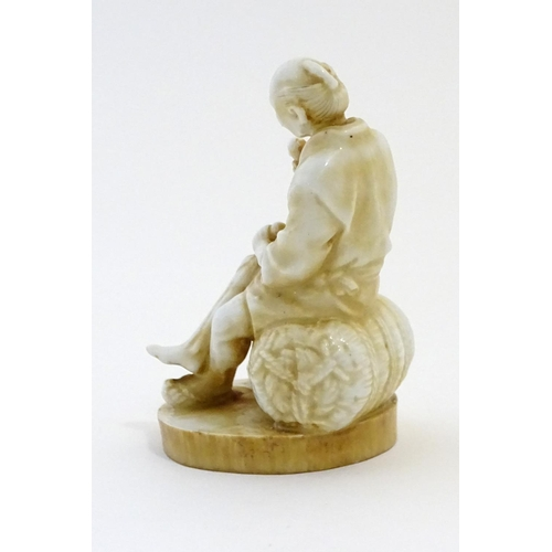 45 - An Oriental figure modelled as a seated man holding an egg with a chicken by his feet. Impressed cha...