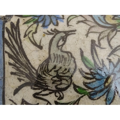 51 - Two Persian tiles of octagonal form decorated with stylised birds and flowers within a blue border. ...