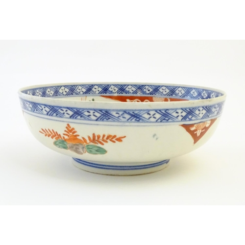 1 - A Japanese bowl with hand painted decoration depicting a landscape scene with flowers, a crane bird ...