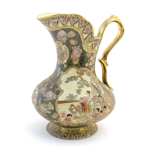 14 - An Oriental jug / ewer with a bulbous body decorated with panels depicting ladies in a garden terrac...