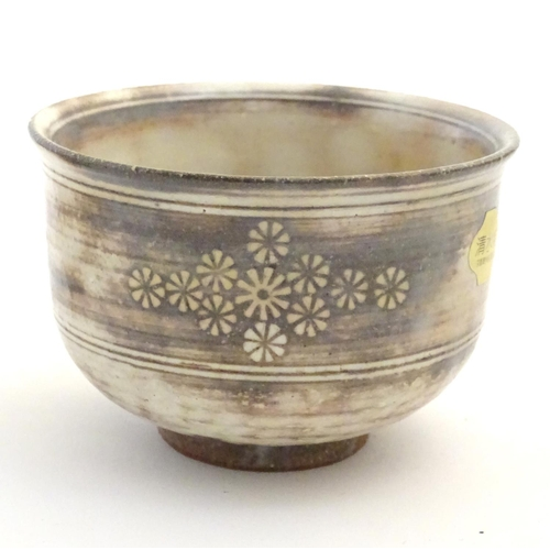 17 - A set of five Japanese chawan / tea bowls decorated with flowers in the Mishima style. Impressed mak...