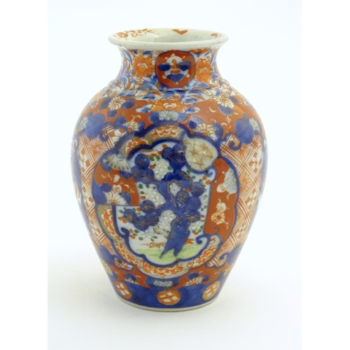 35 - A Japanese vase of baluster form decorated in the Imari palette with floral and foliate motifs. Appr...