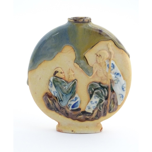 41 - A Japanese Sumida Gawa style moon flask / vase with drip glaze and elder figures in relief. Approx. ...