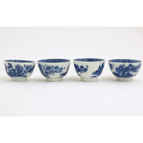 46 - Four blue and white Caughley style tea bowls decorated with landscape scenes with pagodas and figure...