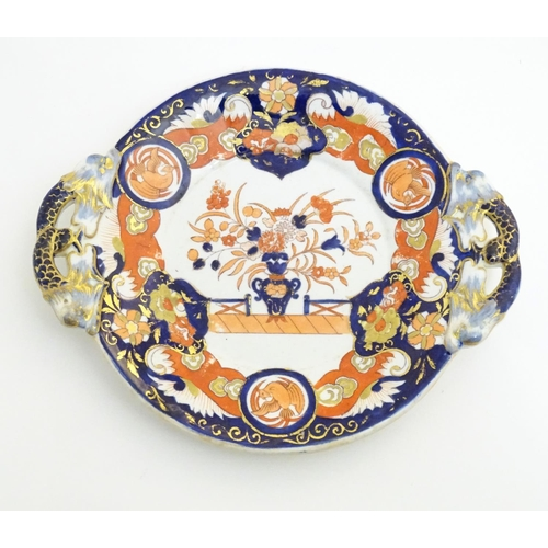 52 - An Ashworth's Ironstone China twin handled plate decorated in the Imari palette with floral motifs, ...