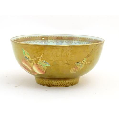53 - A Wedgwood lustre ware bowl with hand painted fruit decoration with gilt highlights. Approx. 2 1/2