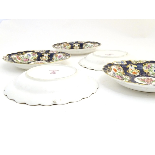 54 - Five 19thC Royal Worcester dessert plates with scalloped rims decorated with hand painted with flowe...