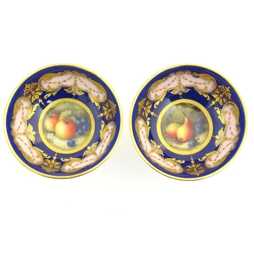 55 - A pair of Royal Worcester sweetmeat / bonbon dishes with a cobalt blue ground with gilt highlights a...