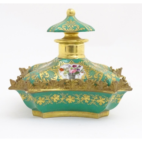 57 - A 19thC Continental dressing table scent bottle / perfume flask with a green ground and gilt highlig...