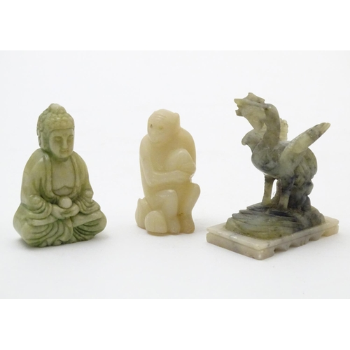 901 - Three Oriental carved items to include a hardstone model of Buddha, a soapstone model of a monkey an...