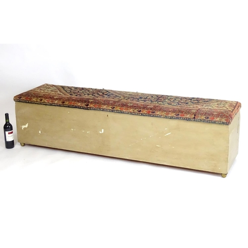 1325 - A late 19thC country house ottoman with an upholstered lid opening to show a divided storage compart...