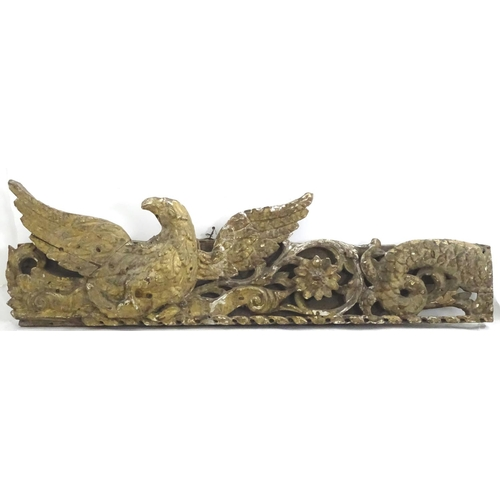 1323 - A Piece of early / mid 18thC carved wood and gesso fragment, depicting a bird amongst foliage accomp...