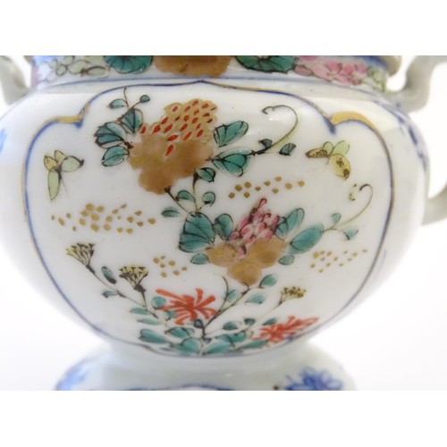 12 - A Japanese teapot, twin handled sugar bowl and milk jug decorated with hand painted insects and pane...