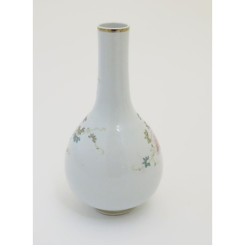 18 - A Chinese globular vase with an elongated neck decorated with peacocks and flowers in a landscape, w...