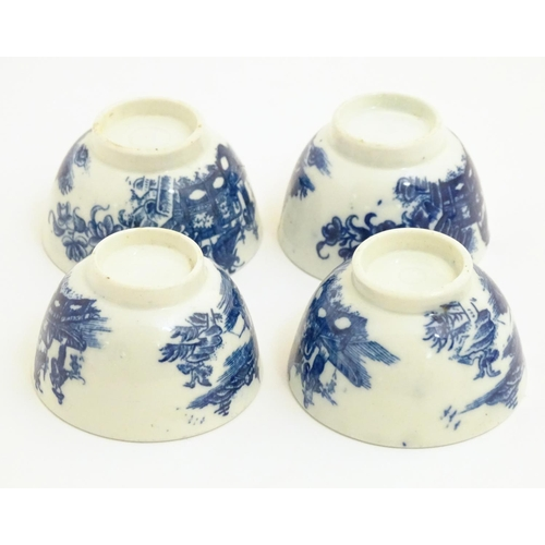 23 - Four blue and white Caughley style tea bowls decorated with landscape scenes with pagodas and figure...