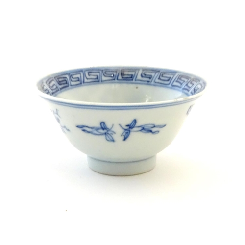 31 - Three assorted Oriental blue and white wares to include sake cup, tea bowls etc. Character marks und...