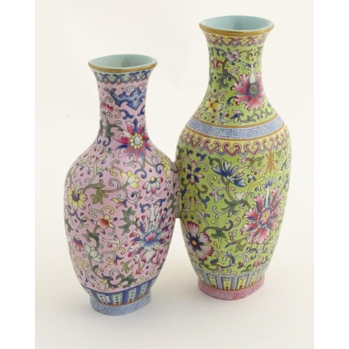 56 - A Chinese famille rose double vase, joined at the shoulder. Each decorated with doucai style scrolli...