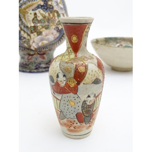 72 - Three assorted Oriental items comprising a large Japanese vase with twin handles decorated with flow...