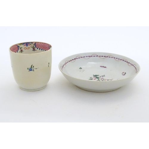 84 - A New Hall tea cup with hand painted floral decoration. Together with a saucer with hand painted flo...