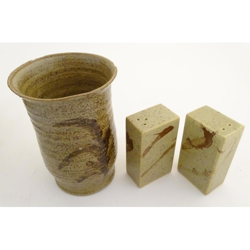 105 - A quantity of assorted studio pottery wares, to include vases, a salt and pepper of rectangular form...