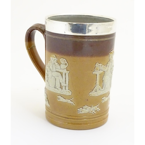 125 - A Royal Doulton salt glaze two tone tankard with a silver rim hallmarked Sheffield 1909, maker Lee &...