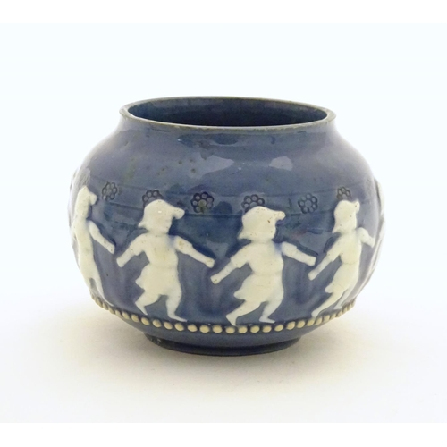 133 - A Doulton Lambeth style circular pot with banded decoration depicting dancing children. Marked under...