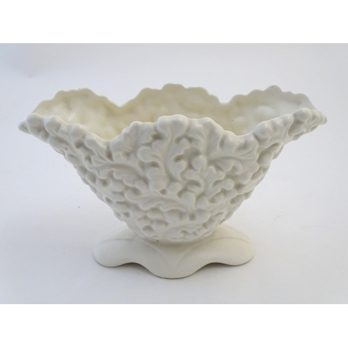 135 - A Sylvac posy holder / vase, the body moulded with a leaf pattern in a white glaze. Approx. 6 1/4