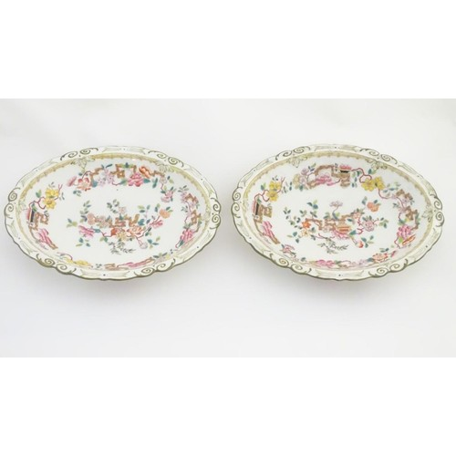 159 - A pair of 19thC oval dishes with hand painted decoration of oriental style stylised scrolling flower...