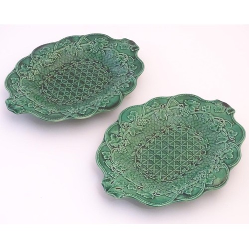 170 - A pair of Wedgwood majolica oval plates with lobed rims and green lustre glaze, decorated with mould...