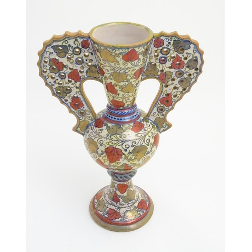 175 - A late 20thC Italian Gu-shaped vase with large wavy edged handles with pierced decoration, decorated...