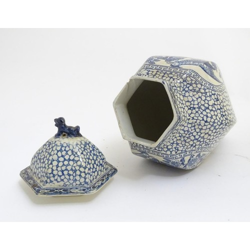 178 - A blue and white hexagonal lidded ginger jar by W. M. Adams, in the pattern Chinese Bird, with panel...